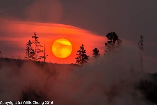 Rising sun over ridge at Black Sand Basin, Yellowstone National Park, Wyoming
