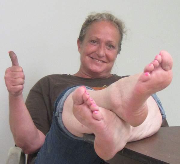 Carol Oxman relaxing and thumbing up