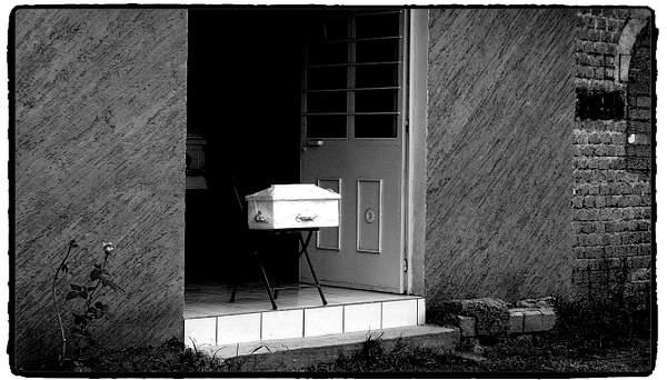 Casket in doorway.
