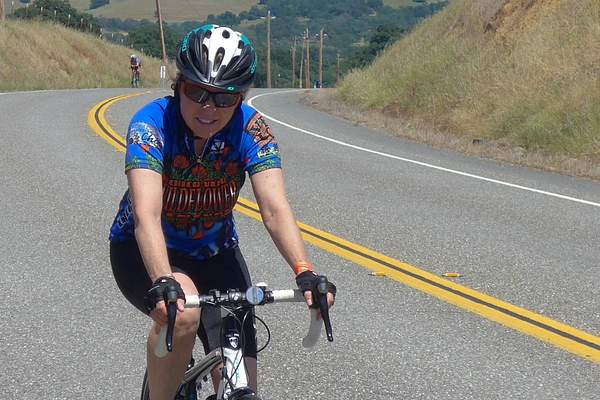 Cyclist with a Wildflower Jersey