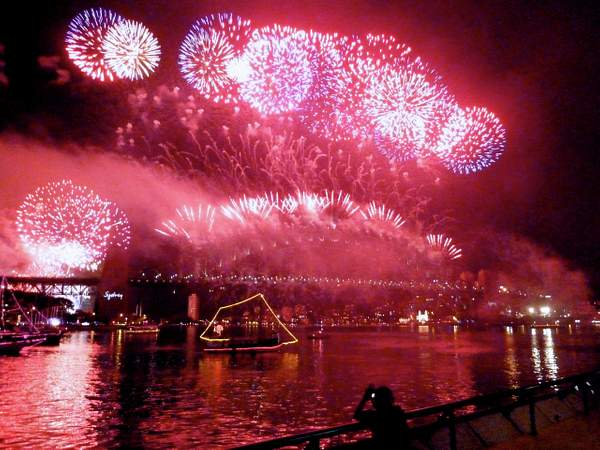 The Harbor Bridge in Sydney explodes with fireworks for New Year's